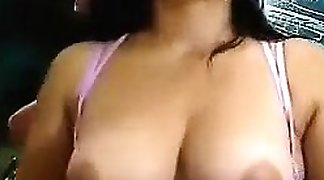 A cute and sexy figure shows her boobs in a webcam. She is